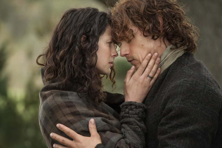 Claire and Jamie embrace in Outlander